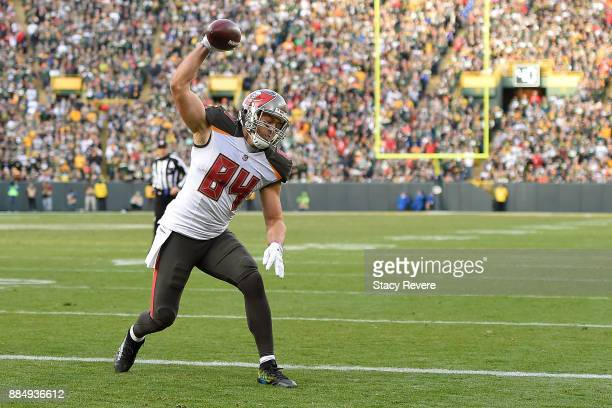 Cameron Brate of the Tampa Bay Buccaneers celebrates a touchdown against the Green Bay Packers during the second half at Lambeau Field on December 3...