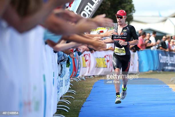 Cameron Brown heads to the finishing line during the Port of Tauranga Half Ironman on January 10 2015 in Tauranga New Zealand