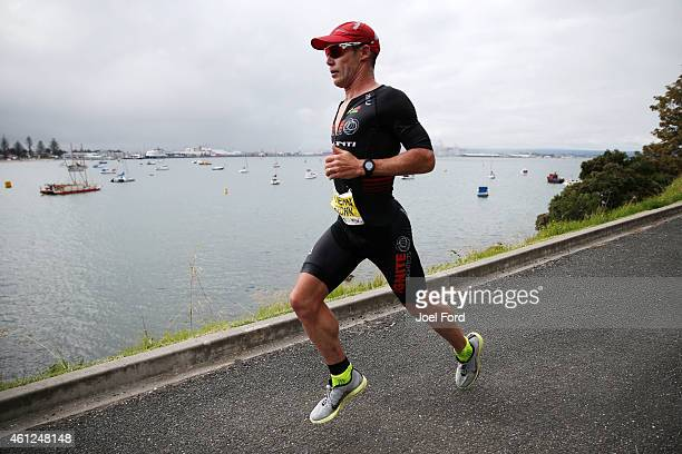 Cameron Brown on the run leg of the Port of Tauranga Half Ironman on January 10 2015 in Tauranga New Zealand