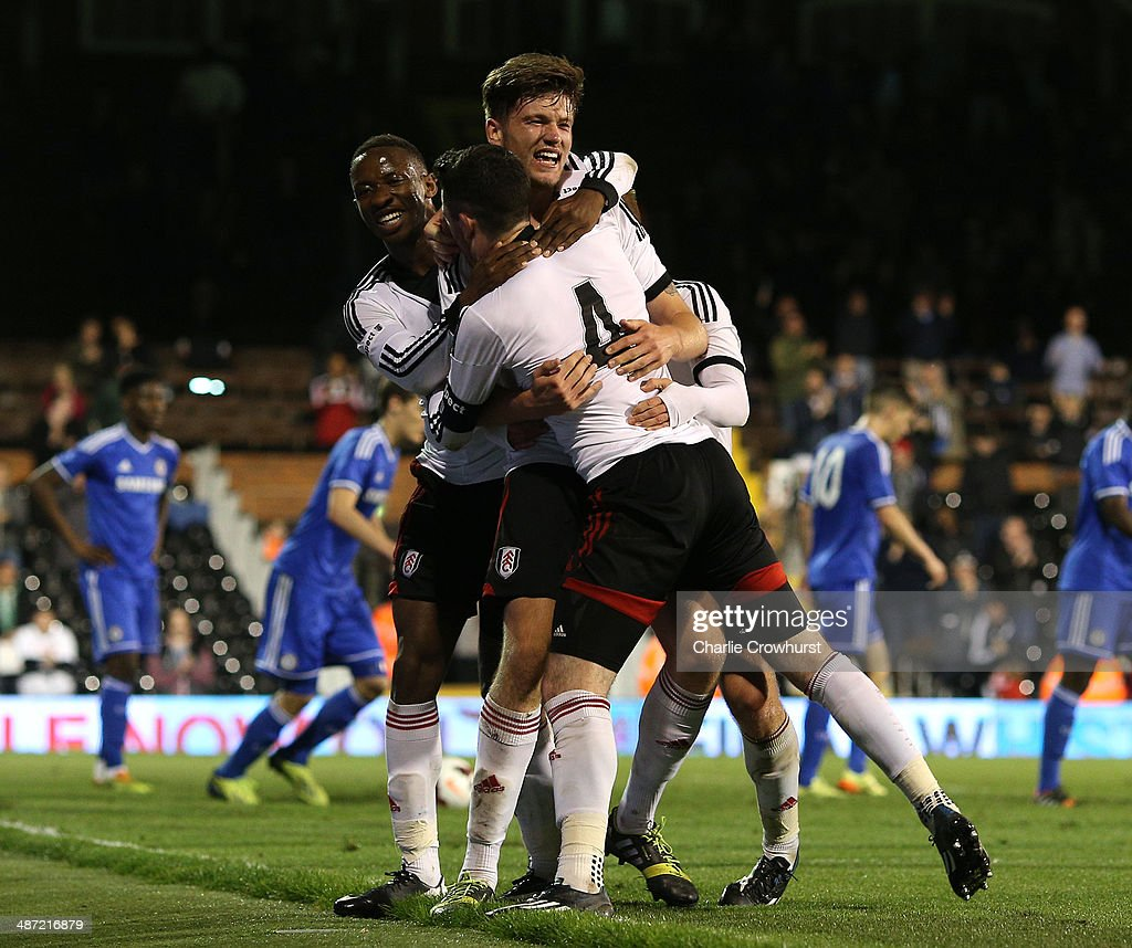 Cameron Burgess of Fulham (C) celebrates with team mates after scoring the teams third goal during the FA Youth Cup Final: First Leg match between Fulham and Chelsea at Craven Cottage on April 28, 2014 in London, England.
