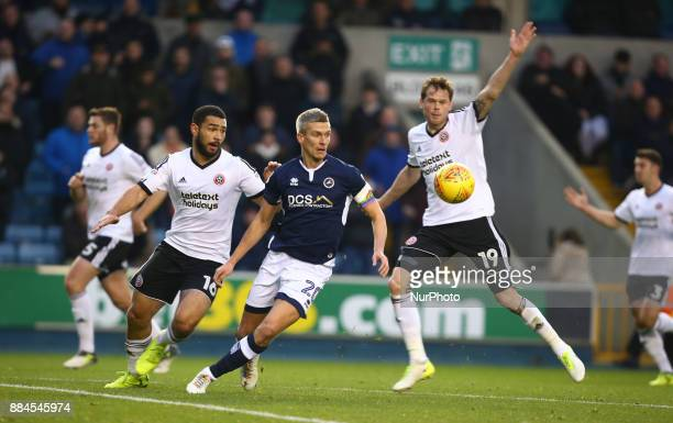 LT Cameron CarterVickers of Sheffield United Steve Morison of Millwall and Richard Stearman of Sheffield United during Sky Bet Championship match...