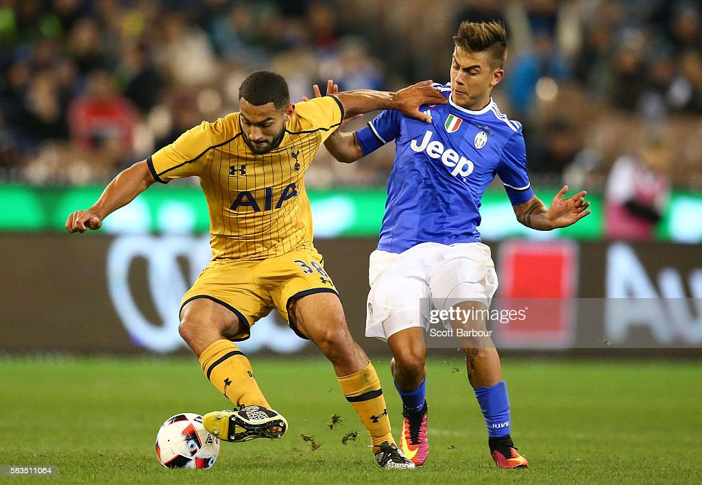 Cameron Carter-Vickers of Tottenham Hotspur and Paulo Dybala of Juventus FC compete for the ball during the 2016 International Champions Cup match between Juventus FC and Tottenham Hotspur at Melbourne Cricket Ground on July 26, 2016 in Melbourne, Australia.