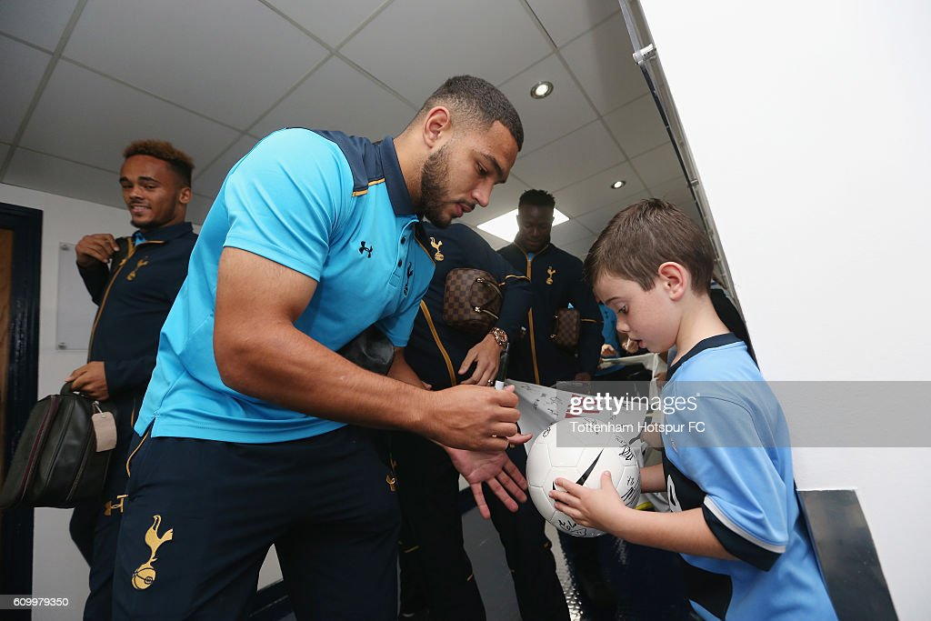Cameron Carter-Vickers signs autographs for mascots during the EFL Cup Third Round match between Tottenham Hotspur and Gillingham at White Hart Lane on September 21, 2016 in London, England.