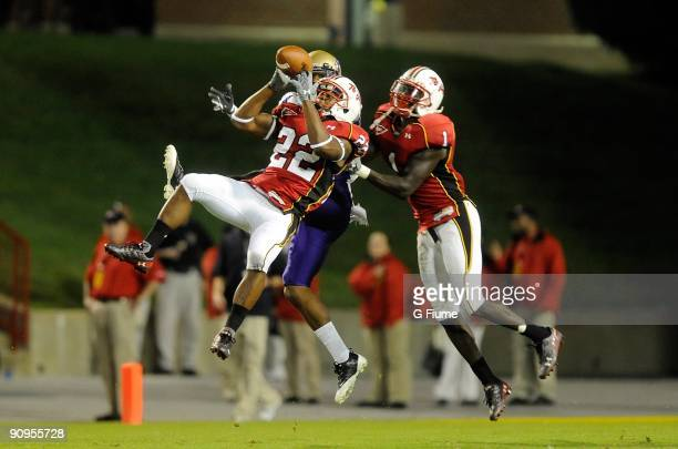 Cameron Chism and Terrell Skinner of the Maryland Terrapins break up a pass during the game against the James Madison Dukes at Byrd Stadium on...