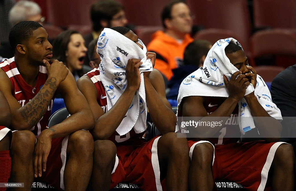 Cameron Clark #21, Buddy Hield #3 and Sam Grooms #1 of the Oklahoma Sooners sit on the bench dejected in the closing seconds against the San Diego State Aztecs during the second round of the 2013 NCAA Men's Basketball Tournament at Wells Fargo Center on March 22, 2013 in Philadelphia, Pennsylvania.