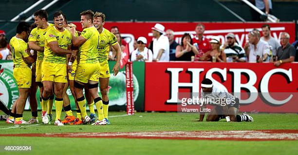 Cameron Clark of Australia celebrates scoring a try to beat Fiji during day two of the Emirates Dubai Sevens HSBC Sevens World Series at The Sevens...