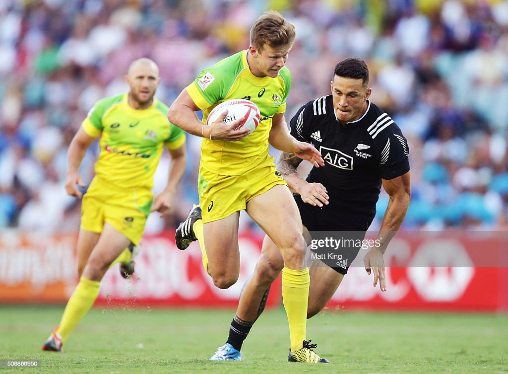 Cameron Clark of Australia gets away from <a gi-track='captionPersonalityLinkClicked' href=/galleries/search?phrase=Sonny+Bill+Williams&family=editorial&specificpeople=204424 ng-click='$event.stopPropagation()'>Sonny Bill Williams</a> of New Zealand during the 2016 Sydney Sevens Cup Final match between Australia and New Zealand at Allianz Stadium on February 7, 2016 in Sydney, Australia.
