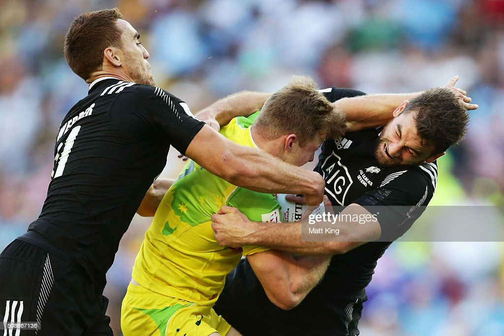 Cameron Clark of Australia is tackled during the 2016 Sydney Sevens Cup Final match between Australia and New Zealand at Allianz Stadium on February 7, 2016 in Sydney, Australia.