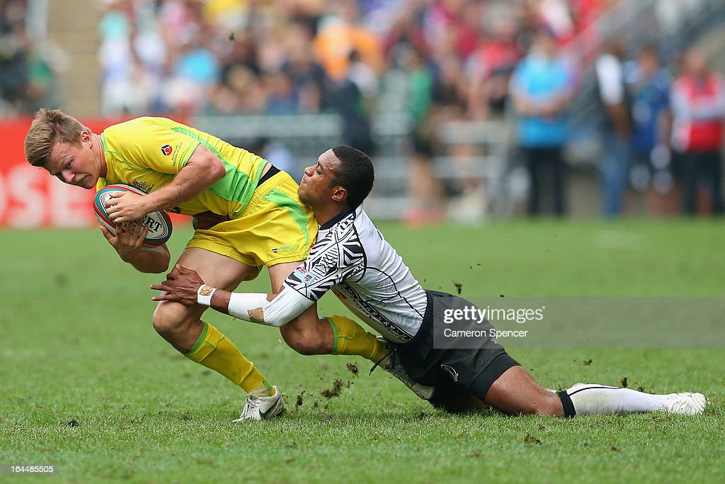 Cameron Clark of Australia is tackled during the Cup Quarter Final match between Australia and Fiji during day three of the 2013 Hong Kong Sevens at Hong Kong Stadium on March 24, 2013 in So Kon Po, Hong Kong.