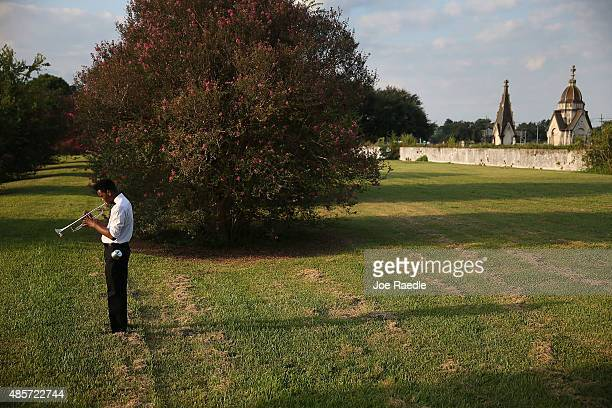 Cameron Clark plays his trumpet before perform during a 10th anniversary of Hurricane Katrina event at the New Orleans Katrina Memorial where nearly...