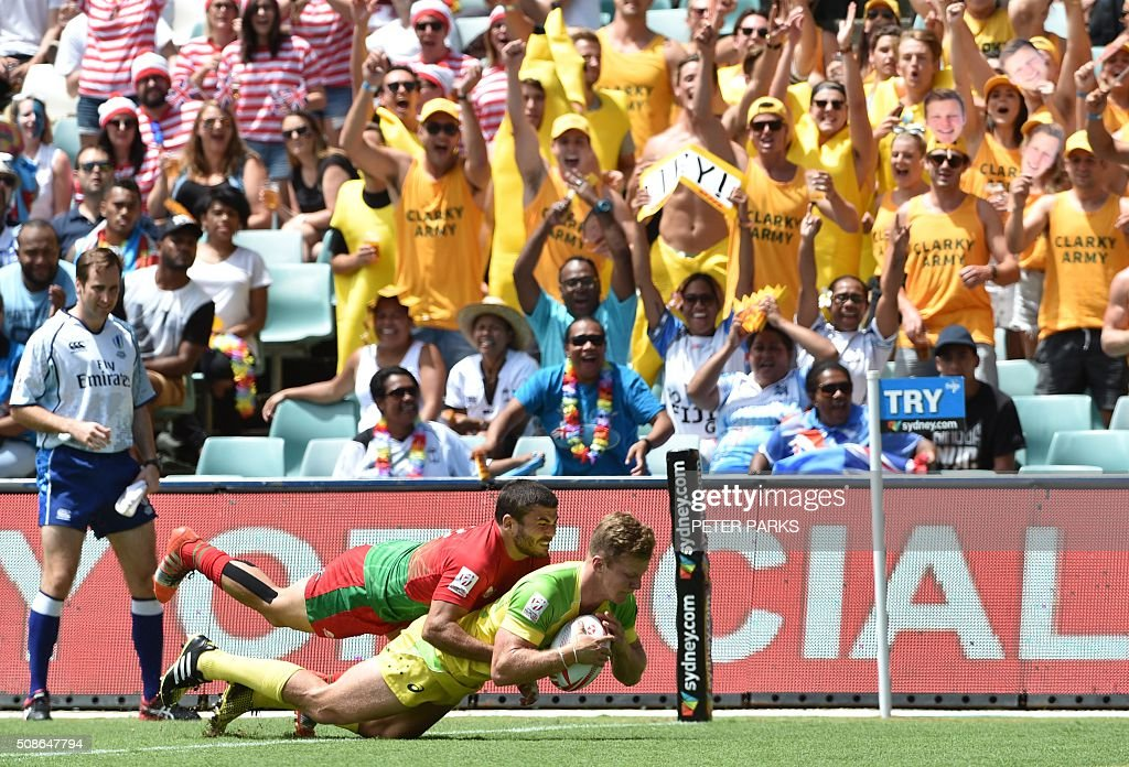Cameron Clarke of Australia (bottom) is tackled by Joao Belo of Portugal (on top) in their Pool A match in the Sydney Sevens rugby Union tournament in Sydney on February 6, 2016. AFP PHOTO / Peter PARKS -- IMAGE RESTRICTED TO EDITORIAL USE - NO COMMERCIAL USE / AFP / PETER PARKS