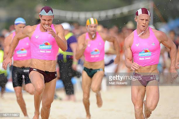 Cameron Cole of Mooloolaba SLSC and Tanyn Lyndon of Northcliffe SLSC sprint to the finsh in the Open Men's Ironman final during the 2013 Australian...