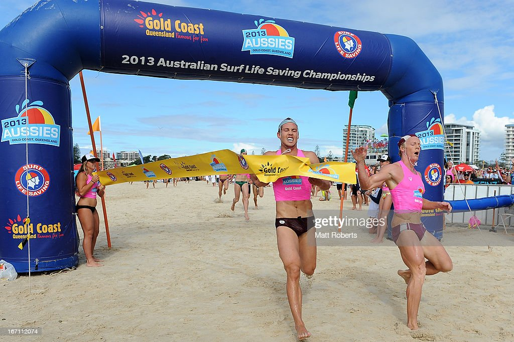 Cameron Cole (R) of Mooloolaba SLSC finshes ahead of Tanyn Lyndon of Northcliffe SLSC in the Open Men's Ironman final during the 2013 Australian National Surf Lifesaving Titles on April 21, 2013 on the Gold Coast, Australia.