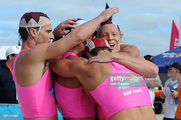 Cameron Cole of Mooloolaba SLSC is congratulated after the Open Men's Ironman final during the 2013 Australian National Surf Lifesaving Titles on...