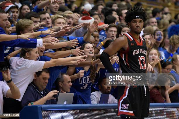 Cameron Crazies and fans of the Duke Blue Devils taunt Keith Braxton of the St Francis Red Flash at Cameron Indoor Stadium on December 5 2017 in...