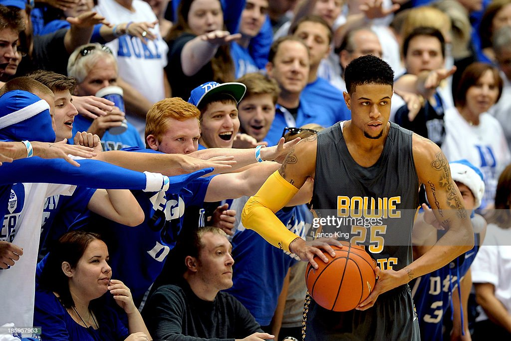 Cameron Crazies and fans of the Duke Blue Devils try to distract Donald Williams #25 of the Bowie State Bulldogs at Cameron Indoor Stadium on October 26, 2013 in Durham, North Carolina. Duke defeated Bowie State 103-67.