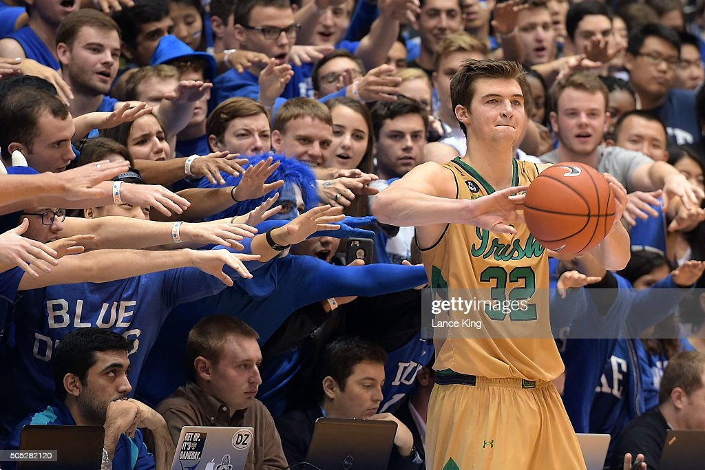 Cameron Crazies and fans of the Duke Blue Devils try to distract Steve Vasturia of the Notre Dame Fighting Irish at Cameron Indoor Stadium on January...