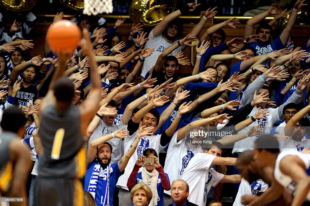 Cameron Crazies and fans of the Duke Blue Devils try to distract Ray Gatling #1 of the Bowie State Bulldogs at Cameron Indoor Stadium on October 26, 2013 in Durham, North Carolina. Duke defeated Bowie State 103-67.
