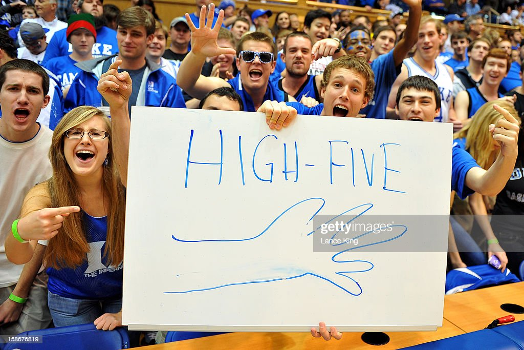 Cameron Crazies of the Duke Blue Devils hold a sign that reads 'HIGH-FIVE' prior to a game during a game between the Elon Phoenix and the Duke Blue Devils at Cameron Indoor Stadium on December 20, 2012 in Durham, North Carolina. Duke defeated Elon 76-54.
