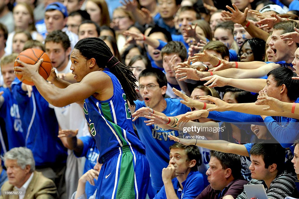 Cameron Crazies of the Duke Blue Devils try to distract Sherwood Brown #25 of the Florida Gulf Coast Eagles at Cameron Indoor Stadium on November 18, 2012 in Durham, North Carolina.