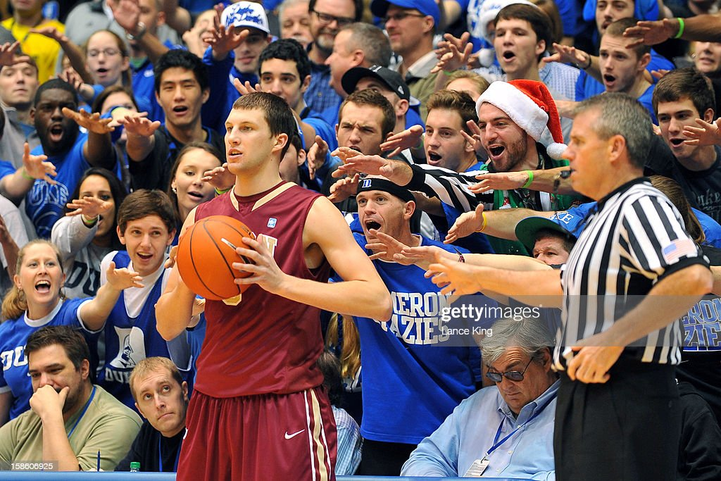 Cameron Crazies of the Duke Blue Devils try to distract Tanner Samson #3 of the Elon Phoenix at Cameron Indoor Stadium on December 20, 2012 in Durham, North Carolina.