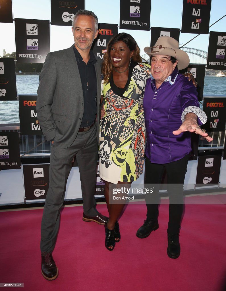 Cameron Daddo,<a gi-track='captionPersonalityLinkClicked' href=/galleries/search?phrase=Marcia+Hines&family=editorial&specificpeople=214612 ng-click='$event.stopPropagation()'>Marcia Hines</a> and <a gi-track='captionPersonalityLinkClicked' href=/galleries/search?phrase=Molly+Meldrum&family=editorial&specificpeople=200714 ng-click='$event.stopPropagation()'>Molly Meldrum</a> arrive at the Foxtel Music Channels Summer Launch at the Botanic Gardens on December 3, 2013 in Sydney, Australia.