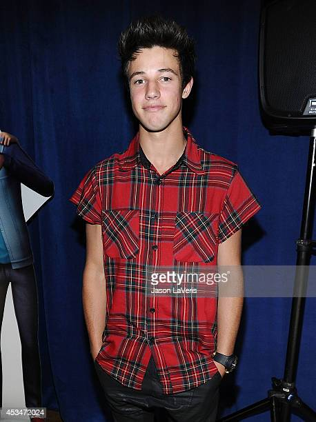 Cameron Dallas poses in the green room at the 2014 Teen Choice Awards at The Shrine Auditorium on August 10 2014 in Los Angeles California