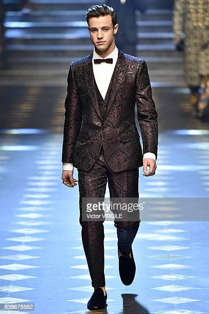 Cameron Dallas walks the runway at the Dolce Gabbana show during Milan Men's Fashion Week Fall/Winter 2017/18 on January 14 2017 in Milan Italy