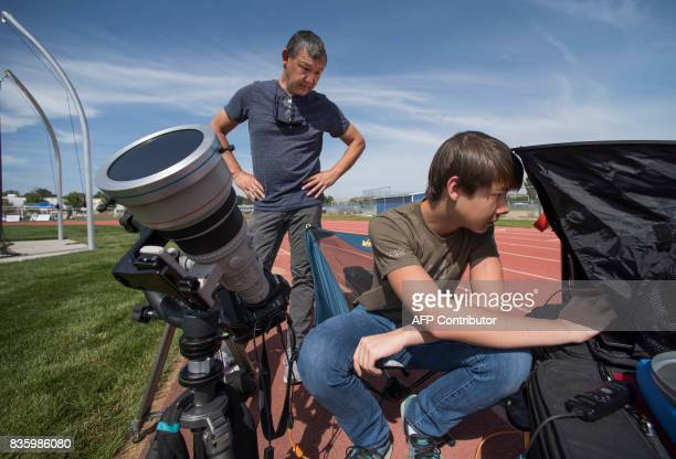 Cameron DaSilva and his father Peter DaSilva of ABC tests camera equipment they will use at the Lowell Observatory Solar Eclipse Experience August 20...
