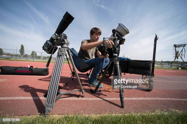 Cameron DaSilva tests camera equipment he and his father Peter DaSilva of ABC will use at the Lowell Observatory Solar Eclipse Experience on August...