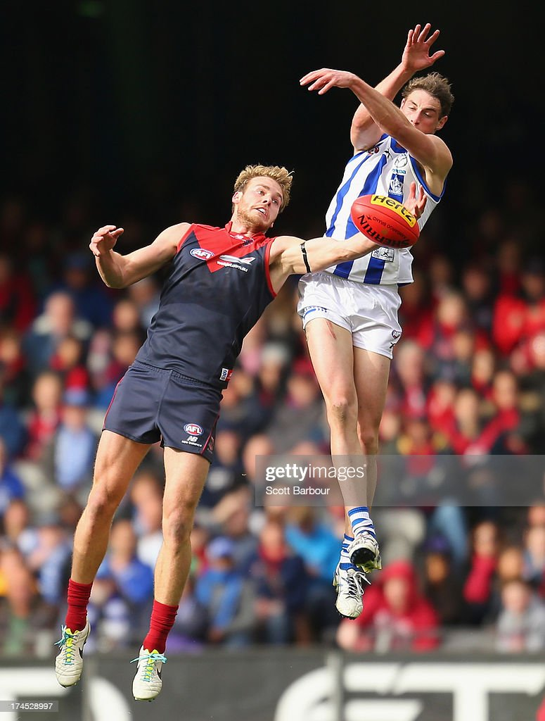 Cameron Delaney of the Kangaroos and Jack Watts of the Demons compete for the ball during the round 18 AFL match between the Melbourne Demons and the North Melbourne Kangaroos at Etihad Stadium on July 27, 2013 in Melbourne, Australia.