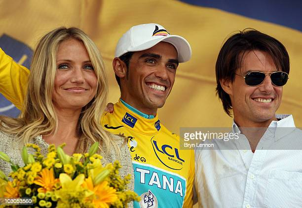 Cameron Diaz and Tom Cruise pose with Tour de France race leader Alberto Contador of Spain and Astana on the podium after stage eighteen of the 2010...