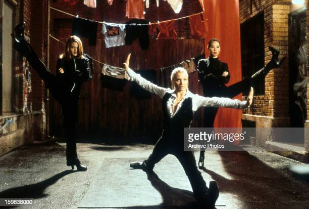 Cameron Diaz Drew Barrymore and Lucy Liu all sporting a different leggy pose in a scene from the film 'Charlie's Angels' 2000