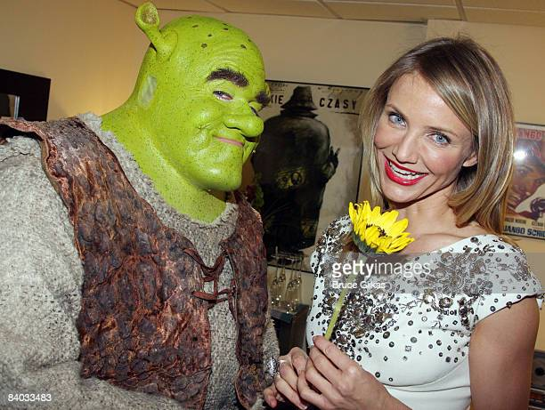 Cameron Diaz visits Brian d'Arcy James as 'Shrek' backstage on opening night of 'Shrek The Musical' on Broadway at the Broadway Theatre on December...