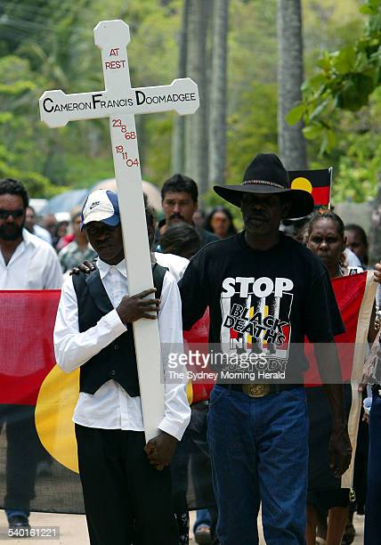 Cameron Doomadgee's son Eric with his cross with other mourners at his father's funeral Cameron died in police custody on Palm Island Queensland 11...
