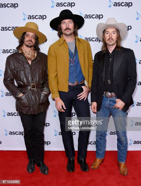 Cameron Duddy Mark Wystrach and Jess Carson of Midland attend the 55th annual ASCAP Country Music awards at the Ryman Auditorium on November 6 2017...