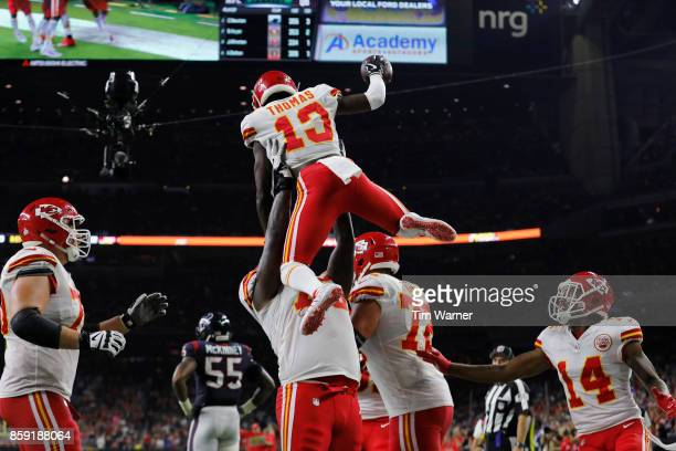 Cameron Erving of the Kansas City Chiefs lifts De'Anthony Thomas in celebration after a touchdown in the third quarter at NRG Stadium on October 8...