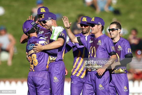 Cameron Fletcher of the Kings is congratulated by teammate Peter Fulton after dismissing Luke Ronchi of the Firebirds during the McDonalds Super...