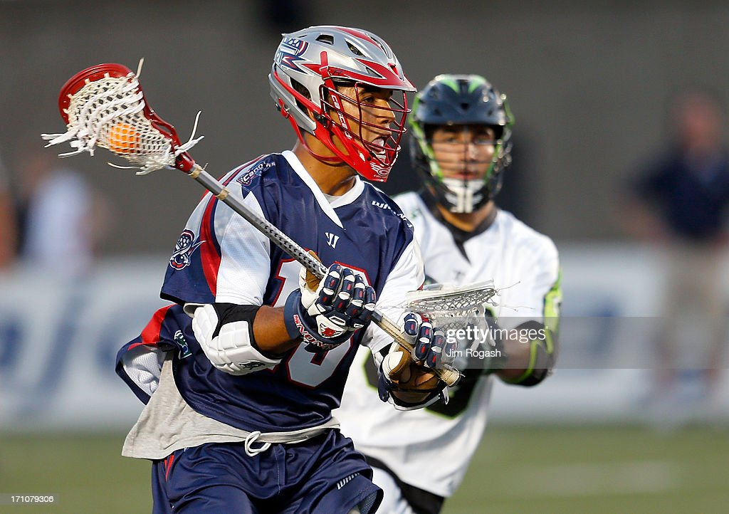 Cameron Flint #18 of the Boston Cannons gets by CJ Costabile #96 of the New York Lizards in the first half at Harvard Stadium on June 21, 2013 in Boston, Massachusetts.