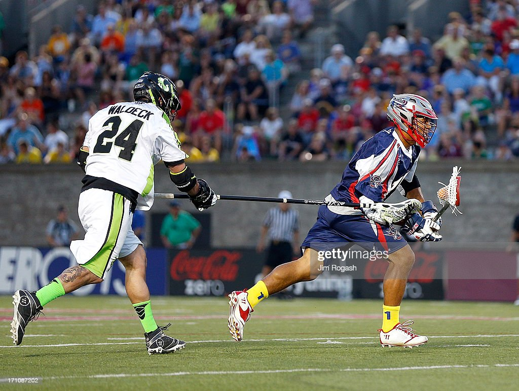 Cameron Flint #18 of the Boston Cannons gets by Steven Waldeck #24 of the New York Lizards toward the net in the first half at Harvard Stadium on June 21, 2013 in Boston, Massachusetts.