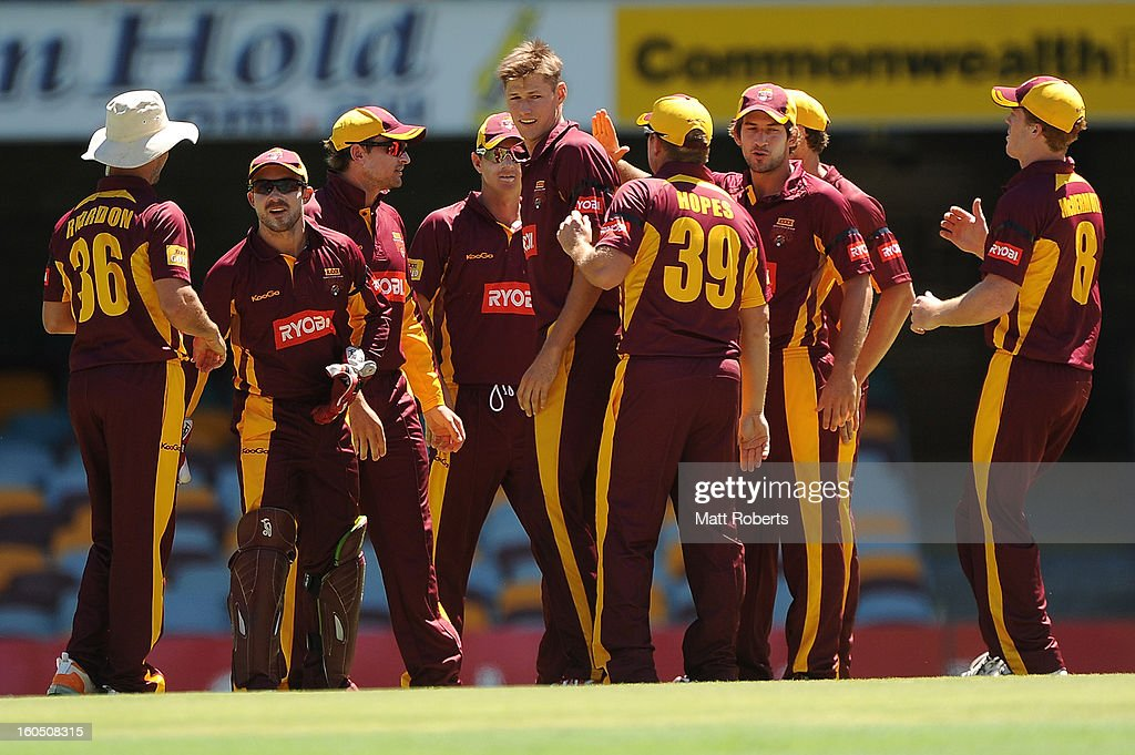 Cameron Gannon (C) of the Bulls celebrates a wicket with team mates during the Ryobi One Day Cup match between the Queensland Bulls and the Western Australia Warriors at The Gabba on February 2, 2013 in Brisbane, Australia.