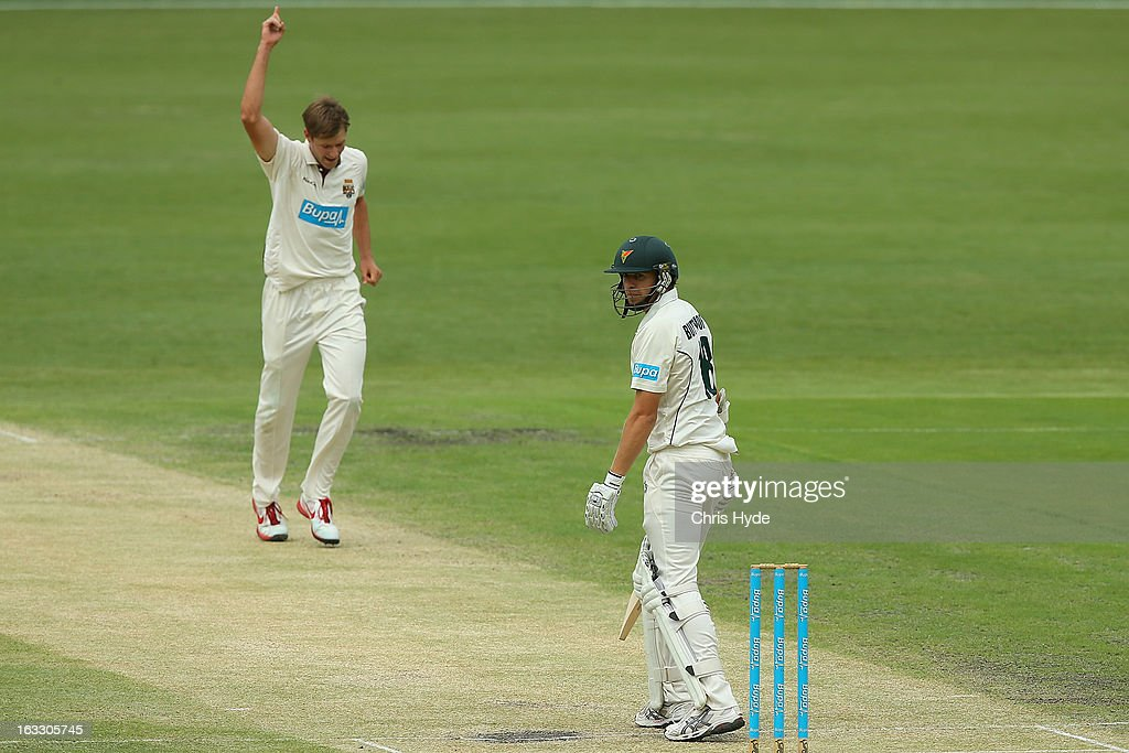 Cameron Gannon of the Bulls celebrates after dismissing Luke Butterworth of the Tigers during day two of the Sheffield Shield match between the Queensland Bulls and the Tasmanian Tigers at The Gabba on March 8, 2013 in Brisbane, Australia.