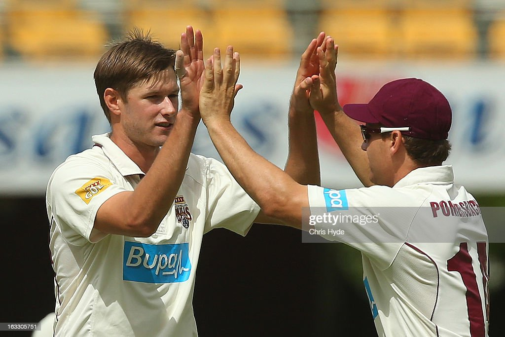 Cameron Gannon of the Bulls celebrates with team mates after dismissing Ben Hilfenhaus of the Tigers during day two of the Sheffield Shield match between the Queensland Bulls and the Tasmanian Tigers at The Gabba on March 8, 2013 in Brisbane, Australia.