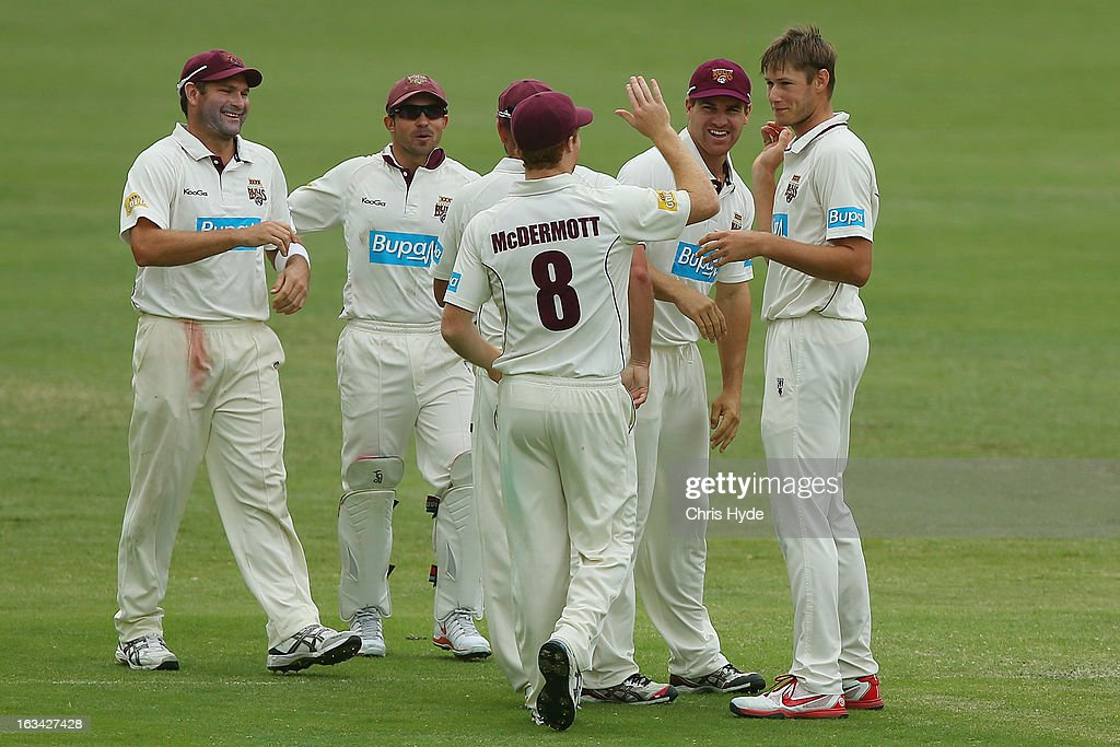 Cameron Gannon of the Bulls celebrates with team mates after dismissing Jon Wells of the Tigers during day four of the Sheffield Shield match between the Queensland Bulls and the Tasmanian Tigers at The Gabba on March 10, 2013 in Brisbane, Australia.