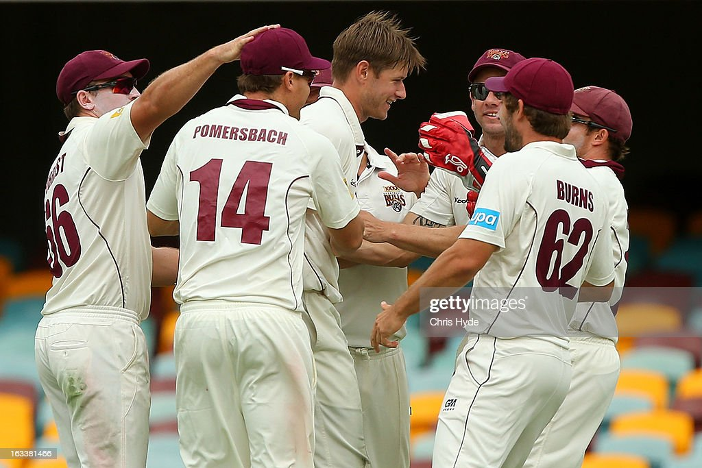 Cameron Gannon of the Bulls celebrates with team mates after dismissing Jordan Silk of the Tigers during day three of the Sheffield Shield match between the Queensland Bulls and the Tasmanian Tigers at The Gabba on March 9, 2013 in Brisbane, Australia.