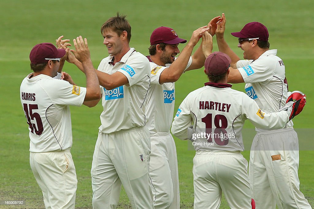 Cameron Gannon of the Bulls celebrates with team mates after dismissing Luke Butterworth of the Tigers during day two of the Sheffield Shield match between the Queensland Bulls and the Tasmanian Tigers at The Gabba on March 8, 2013 in Brisbane, Australia.