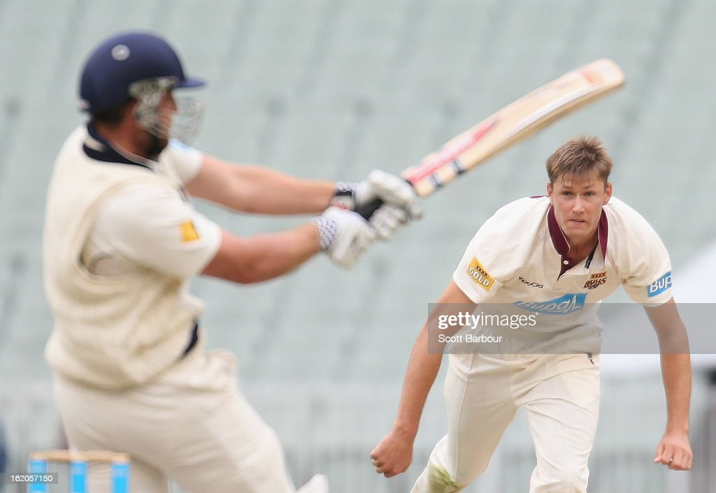 Cameron Gannon of the Bulls follows through after bowling as Michael Hill of the Bushrangers bats during day two of the Sheffield Shield match between the Victorian Bushrangers and Queensland Bulls at Melbourne Cricket Ground on February 19, 2013 in Melbourne, Australia.