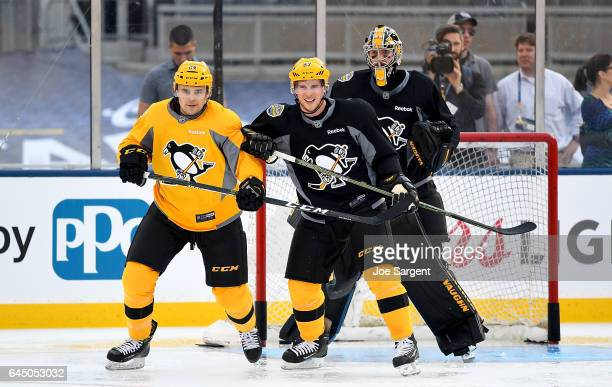 Cameron Gaunce Sidney Crosby and Matt Murray of the Pittsburgh Penguins skate during practice at Heinz Field on February 24 2017 in Pittsburgh...