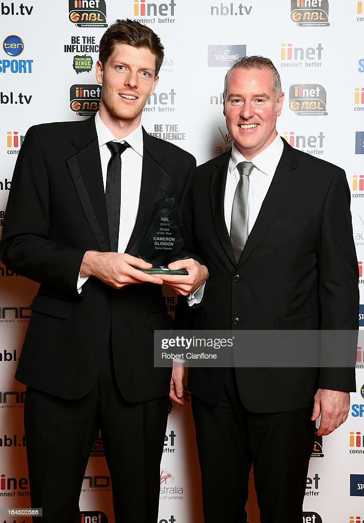 Cameron Gliddon of the Cairns Taipans poses with Bruce Abraham after winning the Rookie of the Year Award during the 2013 Basketball Australia MVP Awards at Crown Palladium on March 24, 2013 in Melbourne, Australia.