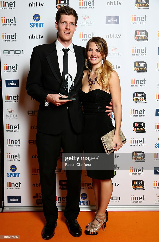 Cameron Gliddon of the Cairns Taipans poses with his partner Sarah Lindley after winning the Rookie of the Year Award during the 2013 Basketball Australia MVP Awards at Crown Palladium on March 24, 2013 in Melbourne, Australia.